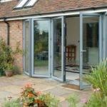 House with bi-folding doors on patio