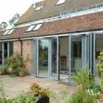 Open bi-folding doors on residential house