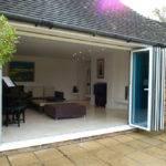 Fully open bi-folding doors on residential patio area